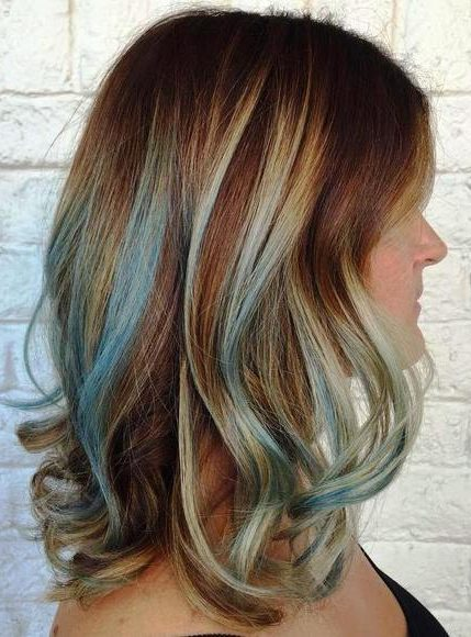 medium brown hairstyle with pastel blue highlights
